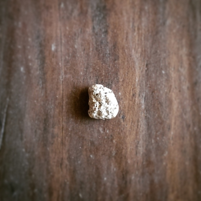 piece of concrete in bag of coffee